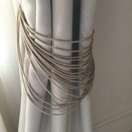 Linen curtain with string tiebacks at Hotel Sant Francesc Palma