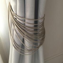Linen curtain with string tiebacks at Hotel Sant Francesc Palma